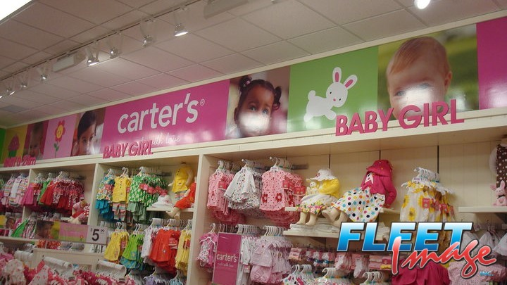 carter's sticker posted on a mall's wall