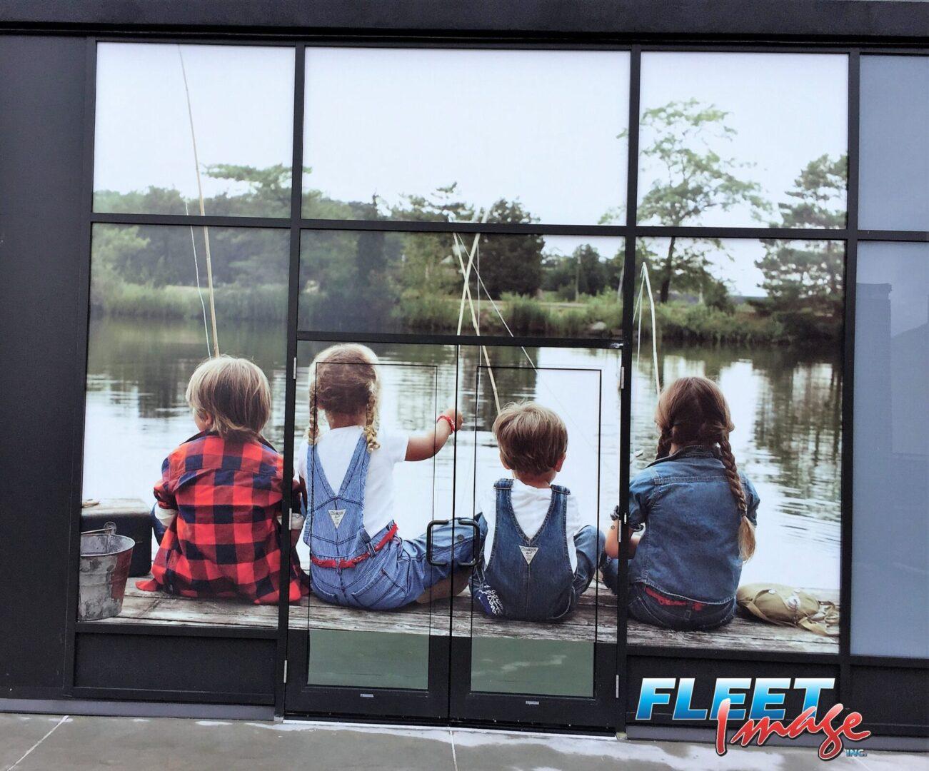 Window graphics of children fishing