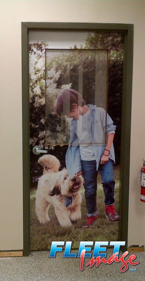 A boy and a dog door sticker