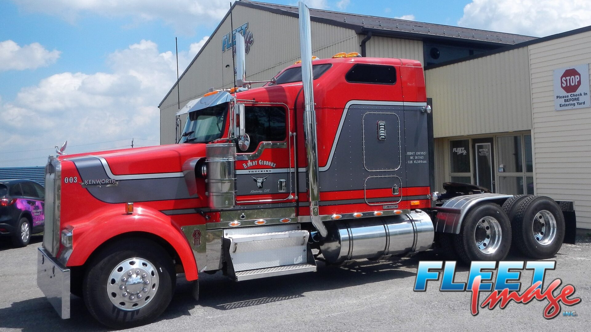 Randy Gibbons Trucking red and gray truck