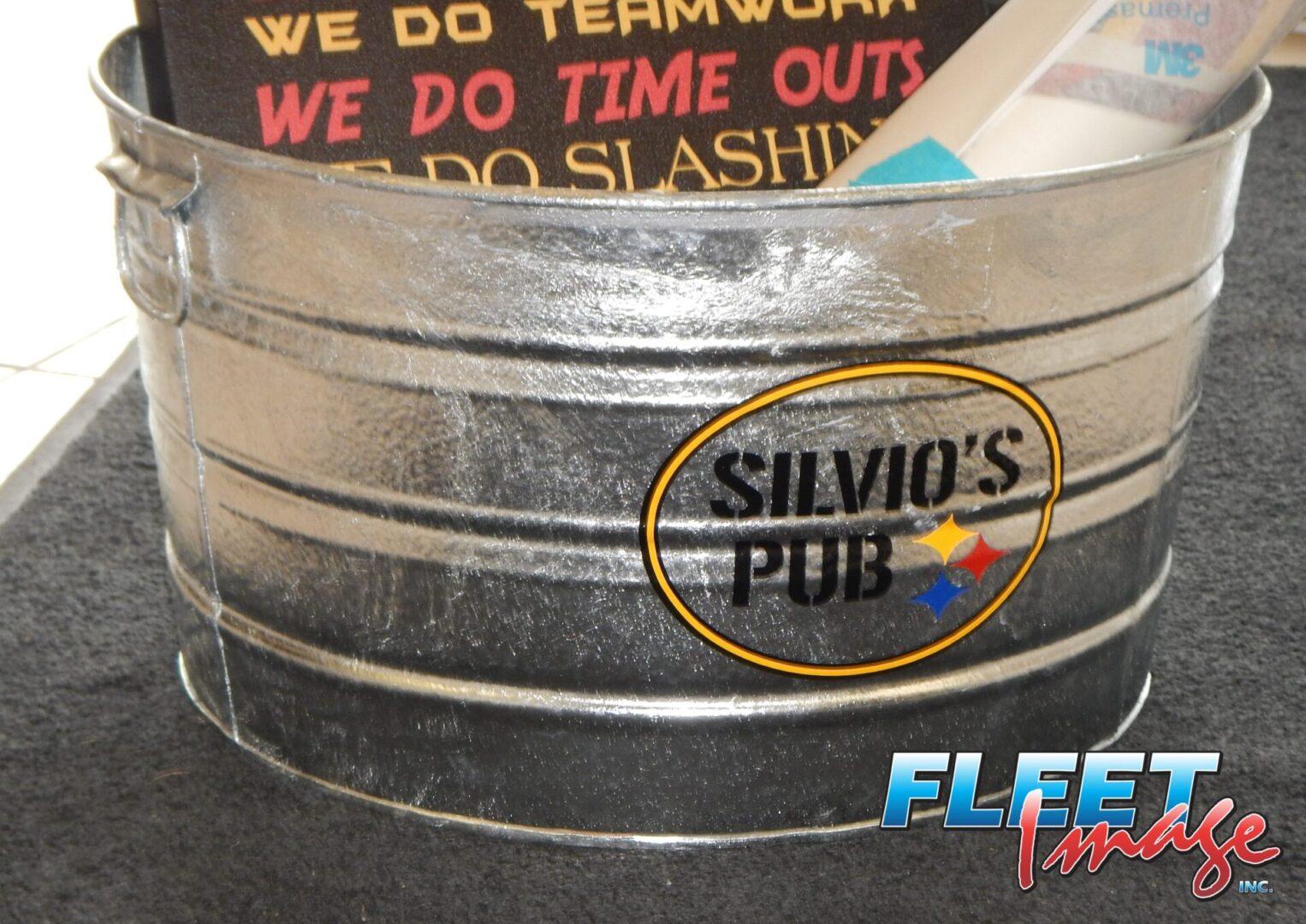 Silvio's Pub sticker on a bucket