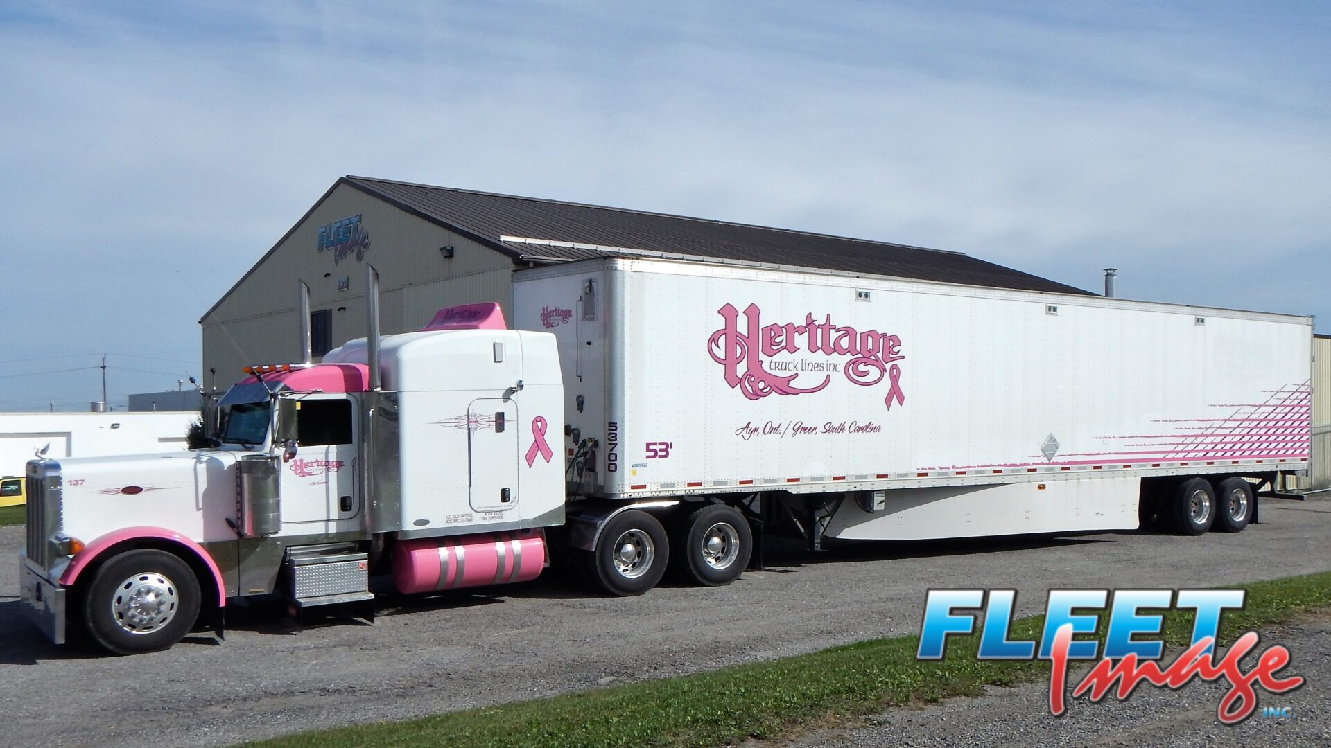 Heritage Truck Lines Inc. white and pink truck