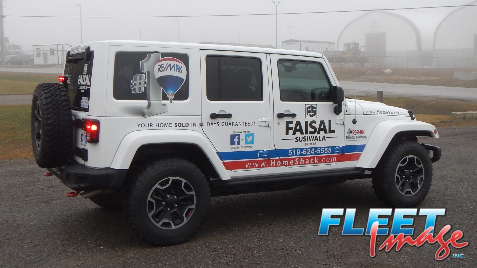 Vehicle with a FAISAL SUSIWALA BROKER decal sticker