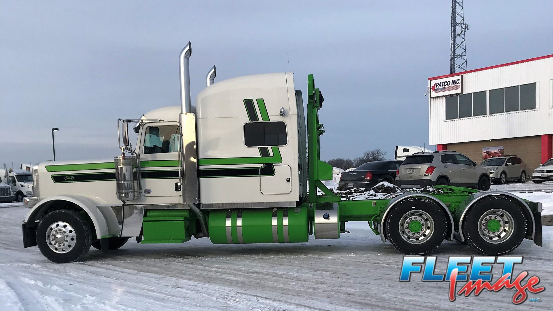 Green and white truck