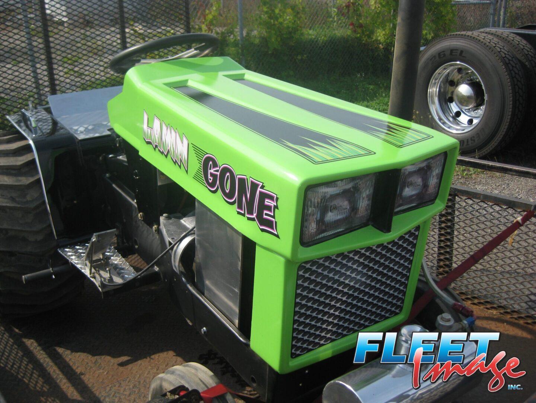 LAWN GONE sticker on a lawnmower vehicle