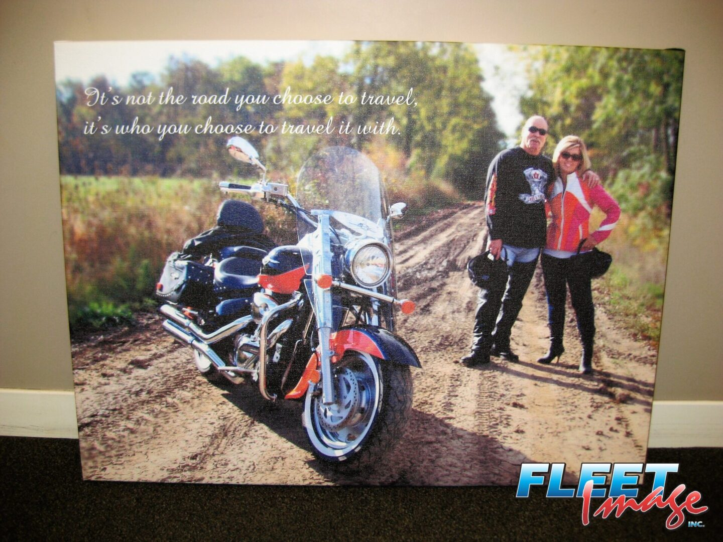Wall art of a couple motorcyclists