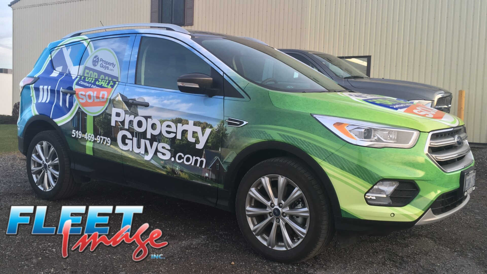 Vehicle with a PropertyGuys.com decal sticker