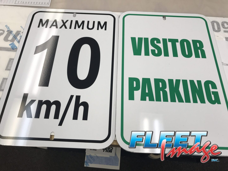 MAXIMUM 10 km/h and VISITORS PARKING signages