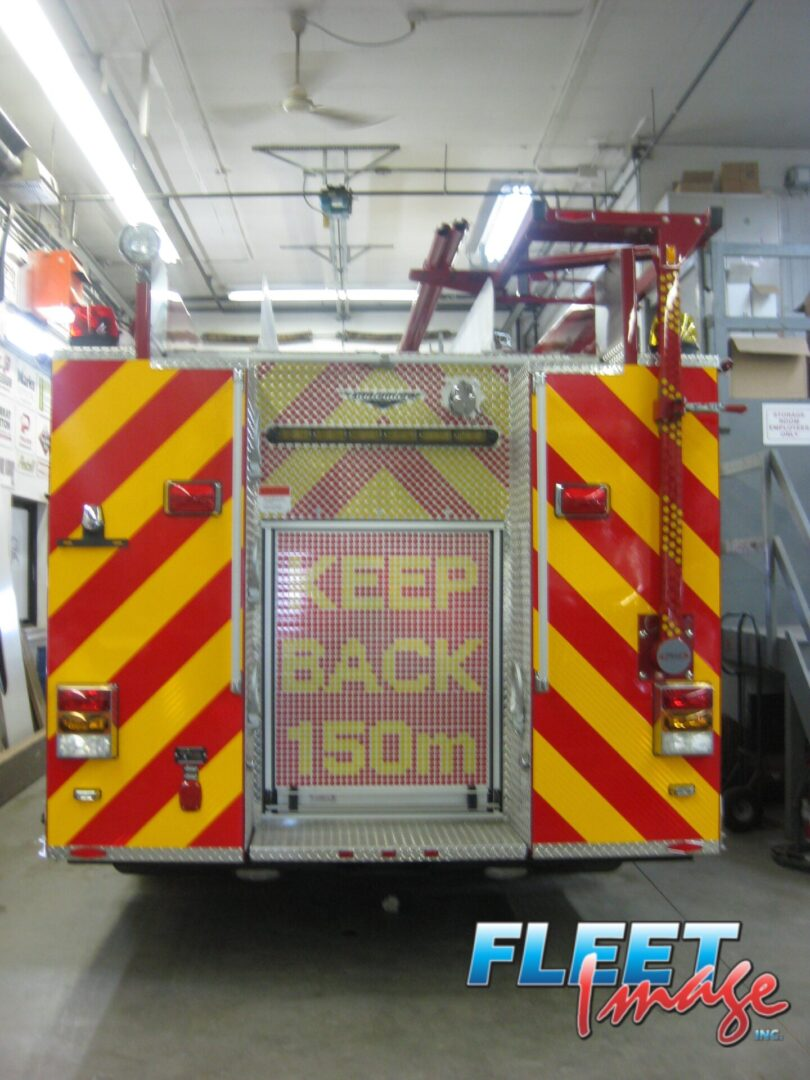 KEEP BACK 150m decal on a fire truck
